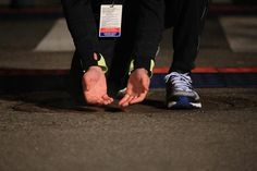An official warms his hands up on the sewer cover before the start of the 2013 Detroit Free Press/Talmer Bank Marathon in Detroit on Sunday, Oct. Detroit Free Press, His Hands, Marathon, Sunday, Cover, Photography, Fotografie, Photograph, Marathons