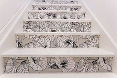 or wallpaper the stairs?  different wallpaper, and black instead of white.