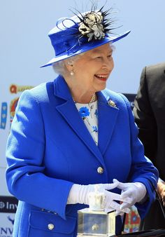 Queen Elizabeth Looks on during the Investec Derby marking the start of the Queens Diamond Jubilee Celebrations