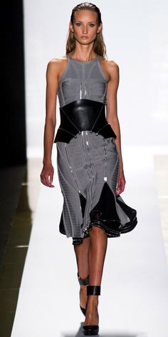 HERVE LEGER BY MAX AZRIA: Silver bandage multi-zipper sleeveless dress, black cotton eyelet skirt, black leather multi-zipper corset belt and black leather ankle-strap pump