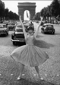 Shirley McLaine. Stopping traffic. In the middle of Champs-Élysées.