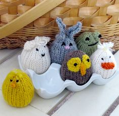 Free Knitting Pattern for Eggkins - Six egg-shaped animal toys perfect for Easter baskets or egg cups. Left to right (front row): chick, owlet, duckling; (back row): lamb, bunny, frog.. DK yarn. Designed by Chris de Longpre