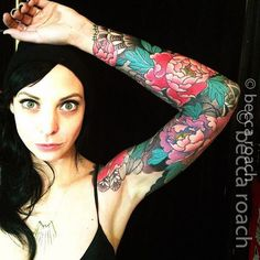 Vibrant floral sleeve tattoo by Becca Roach of Queen Street Tattoo.
