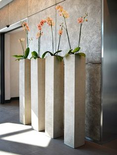 Tall planters can decorate a large space or serve as a focal point for several smaller plants. There are alternate ways to fill your planters. Concrete Furniture, Concrete Pots, Concrete Crafts, Concrete Garden, Recycled Furniture, Tall Planters, Indoor Planters, Ceramic Planters, Orchid Planters
