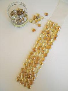 Dollar Store Glass Stones ◾Dollar store glass stones, usually sold with vases for floral ◾Mosaic clear mounting sheets (craft store) ◾Mastic ◾Notched Trowel ◾Grout ◾Grout float