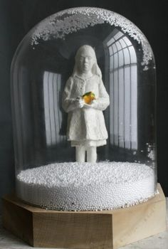 Sculpture of girl with totoise like in a christmass ball, by Jeanne Isabelle Corniere, resin