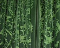 """Emery & cie - Fabrics.  Peacock-patterned velvet theatrical style drapes, """"Oiseaux""""."""