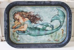 """Sea Beauty Metal Mermaid Tray - Nautical Party Decor - Coastal Kitchen Decor - California Seashell Company  Add a touch of elegance to your nautical or coastal party with this food-safe Sea Beauty Metal Serving Tray. Not only is it perfect for a party, this cute and sturdy tray is great for breakfast in bed or lazy weekend mornings, and makes a great accent piece for a coffee table. Mermaid tray measures 16"""" x 11"""""""