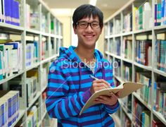 happy asian college student in the library Royalty Free Stock Photo