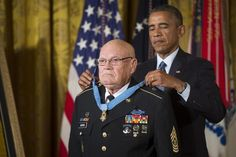 Then-President Barack Obama bestows the Medal of Honor on retired Command Sgt. Maj. Bennie G. Adkins on Sept. 15, 2014. Adkins distinguished himself during 38 hours of close-combat fighting against enemy forces in Vietnam in March 1966. (U.S. Army photo by Staff Sgt. Bernardo Fuller)