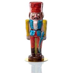 Nothing says Christmas like this hand-painted chocolate nutcracker. Made from dark chocolate, this hollow fellow stands 12 inches tall and is a classic addition to your holiday table. Give the gift of artisan holiday chocolate to your favorite neighbor or friend.To ensure freshness of your items, these will be crafted and ready to ship on November 30th or later.  Please specify date that you would like to receive.  Pre-payment is required, discount will be taken at time of order…