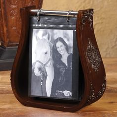 Western Stirrup Photo Album.  I bought one of these a couple of Christmases ago at Don Walker's Western.  It was perfect for my sister and b-i-l. -Mel