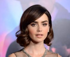 Lily Collins curled bob