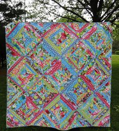 beautiful string quilt using Soul Blossoms.  List of linky parties for each day at the bottom of the blog.