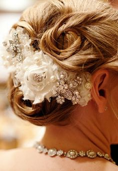 Flowers and crystals adorn this @Four Seasons Resort Jackson Hole bride's updo.