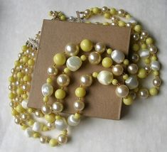 Excited to share the latest addition to my #etsy shop: Vintage Yellow Cream Multi Strand Necklace // 1960s Japan http://etsy.me/2FsQ2Vx #jewelry #necklace #yellow #wedding #easter #white #yes #women #plastic