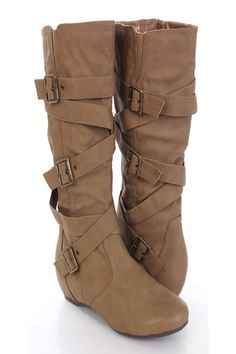 Make a fashion statement with these stylish mid calf boots! Its a must have for stomping around town! Make sure you add these to your closet, it definitely is a must have! The features include faux suede upper with a wrap around strap design, buckle accents, mid calf length, stitched detailing, side zipper closure, smooth lining, and cushioned footbed. Approximately 15 inch circumference and 13 inch shaft.