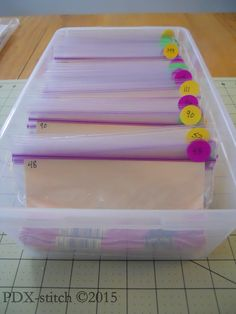 embroidery floss neatly put away in a box