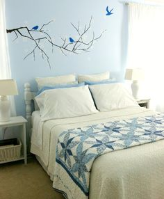 Neutral bedding with a colorful quilt, folded and placed in the middle of the bed, not draped on the end - for the guest room