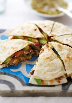 Triple-Decker Quesadilla – A quesadilla made with three flour tortillas stacked with beans, sour cream, cheese, tomatoes and fresh avocados. Triple-decker, triple delicious.
