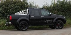 """Lifted Truck, Custom Nissan Navara Frontier, This truck has home made aluminium sport back and 3in straight through stainless steel side exit exhaust, Home painted wheels with custom centres, Lifted 3"""" and oversize Goodridge mud terrain tyres. Candy red 30mm wheel spacers. Also fited auxilery chrome pod mounted gauges and hame made stainless steel interior trim."""