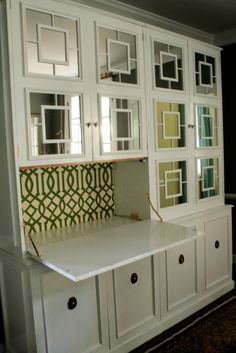White paint, mirrors and applied molding made this cabinet look amazing!
