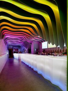 Amazing slatted and backlit ceiling of the E Pra Poncha Bar in Porto, Portugal designed by Antonio Fernandez - #modern #contemporary #ceiling #design #idea #interior #solution #architecture #colorful #rainbow #lights
