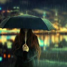 The solemn rain rain bokeh lights girl outdoors sad umbrella