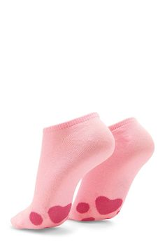 A pair of knit ankle socks featuring a paw print on the bottom and a ribbed trim.