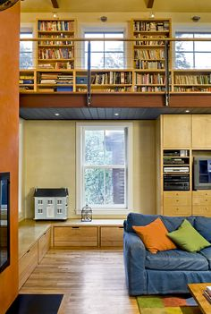 contemporary living room with library at second floor