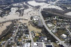 Above, another view of partially-submerge Union, Missouri on Tuesday, December 29 -  a sma...