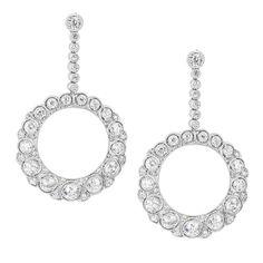 Diamond-Set Platinum Hoop Drop Earrings | From a unique collection of vintage drop earrings at https://www.1stdibs.com/jewelry/earrings/drop-earrings/