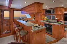 The galley on board performance trawler Hampton Yachts Endurance 658 features granite countertops and raised bar-level seating with locking stools that remain in place in open seas.