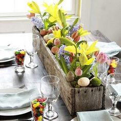 After a good scrub, an outdoor flower box can make for a beautiful table centre piece. Team flowers with the speckled brown of a few eggs shells and you'll know Easter has arrived. http://www.goodhousekeeping.co.uk/lifestyle/home-decorating-ideas/easter-flowers-ideas-for-easter-flower-arrangements