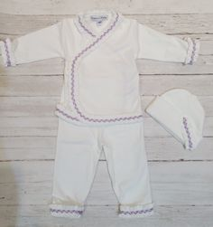 White & Lavender Layette Set from The Couture Baby
