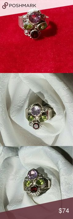 Beautifully Crafted 4 Stone 925 Ring This stunning piece is absolutely gougious.  Four amazing stones set in Sterling Silver.   Ring is a total of 5.7 grams.  Marked 925. Jewelry Rings