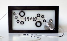 ロープがスルスルっと動いて時刻を表示。シンプルだけど複雑なピタゴラ風の時計|ギズモード・ジャパン