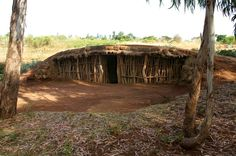 a home in Tanzania Africa , Most are made of Mud and and Sticks they can Find.