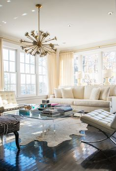 A large midcentury Lucite coffee table displays some of Stearns' favorite treasures: a collection of fashion and design books, lacquered boxes and a cluster of alabaster grapes she discovered at an antique show.