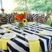 Black and White Stripe Linens, Yellow Napkins, Sunflowers and Wild Flower Centerpieces