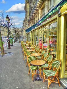 A street scene of chairs lined up outside of a cafe in Paris, France. Mark Currier