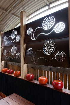 Create a louvered privacy wall in your outdoor courtyard living space! Metal art by Entanglements