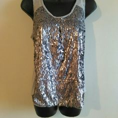 Hot Sequin night out tank Really nice grey and silver sequined tank. Thick lining on inner front. Cute keyhole back detail. Well made top.Made of 100% Rayon. Kenar Tops Tank Tops