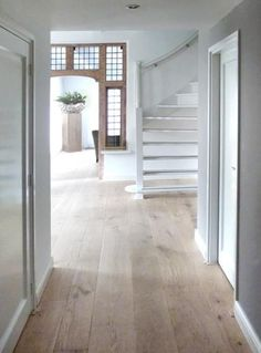 love the clean lines with the rustic feeling floors/and doorway detail