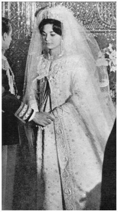 The Wedding of Soraya and the Shah of Iran. The bride wore a silver lamé gown studded with pearls and trimmed with marabou stork feathers, designed for the occasion by Christian Dior. She also wore a full-length female white-mink cape.