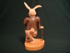 Woodcarving, Easter Rabbit, Easter gift, Valentine Day Gift, Collectable, Wood Carving. This hand carved Bunny is all dressed up in a tux, with his roses and needing somewhere to go. He is 8.5 tall, 4 wide and 3.75 deep and was carved entirely from one piece of wood. This original one