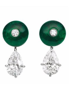 A Pair of Bulgari emerald and Diamond Earclips: Each designed as a cabochon emerald surmount, centrally enhanced by a collet-set diamond, suspending a pear-shaped diamond, mounted in 18K white gold, length 3/4 inch. Signed 'Bulgari'. Via Philips.