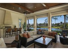 1287 Osprey Trail, Naples, FL  34105 | In Naples life happens outdoors.  Lanai with summer kitchen, fireplace, wood ceiling and lake view.  Estuary at Grey Oaks - Melinda Gunther
