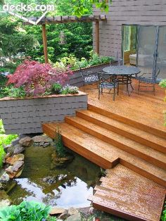 Small coy pond or water feature, raised planter and steps down