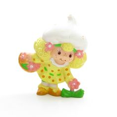 "This vintage Strawberryland Miniatures figurine is ""Lemon Meringue Picking A Flower."" Lemon Meringue is one of Strawberry Shortcake's friends and holds a basket of pink flowers in one hand. She's lean"